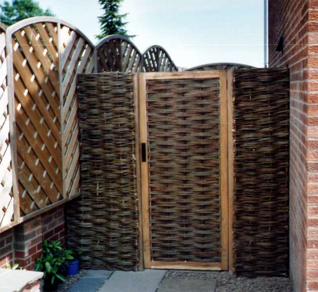 <span>Ref: F33</span><br>An oak gate 6' x 3' wide, with willow infill and adjacent willow panels gives privacy and access to a back garden; £480 inc VAT.