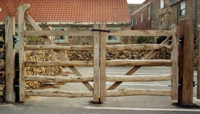 <span>Ref: F16</span><br>Five rail cleft oak gates with sawn ends, the left gate with ranch top brace, both 4' x 4' wide; ranch gate £516 inc VAT, plain gate £396 inc VAT.
