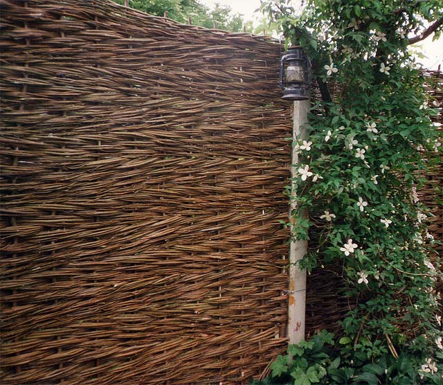 <span>Ref: B13</span><br>The finer willow rods give a more formal appearance, here slotted between concrete posts.