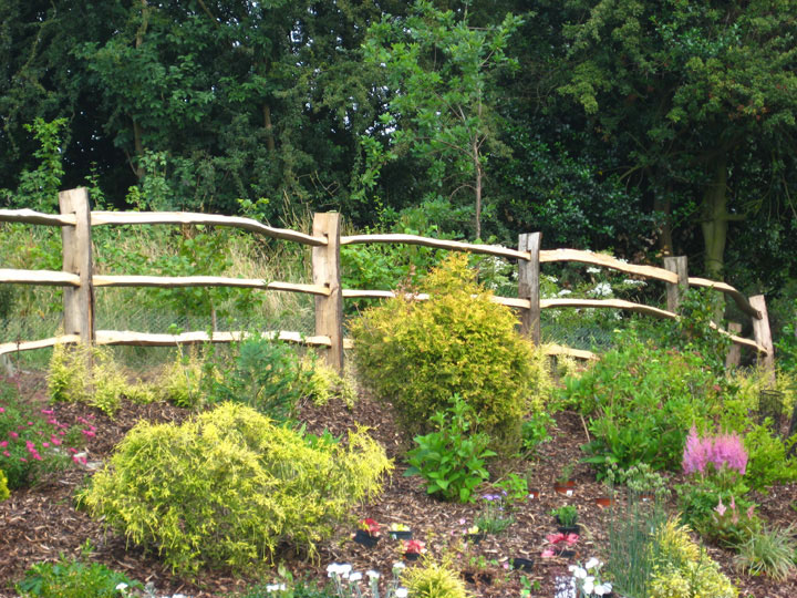 <span>Ref: A8</span><br>Cleft chestnut fencing can separate a garden from the countryside in a more gentle manner than a standard agricultural post and rail fence.Top rail at 4', materials approx £20.15/metre inc. VAT