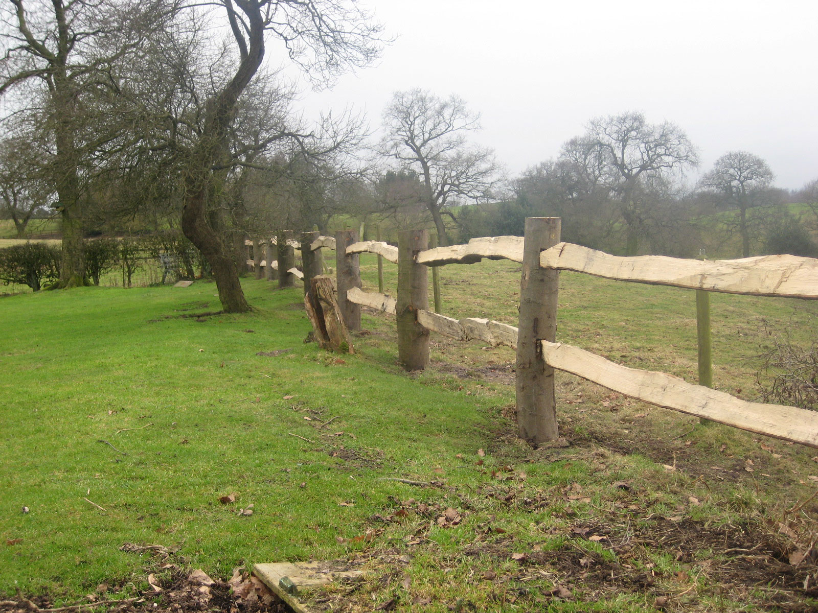 <span>Ref: A10</span><br>Traditional cleft fencing fits well in a rural setting of woods, field and hedgerows. Top rail at 4', materials approx £14.74/metre inc. VAT