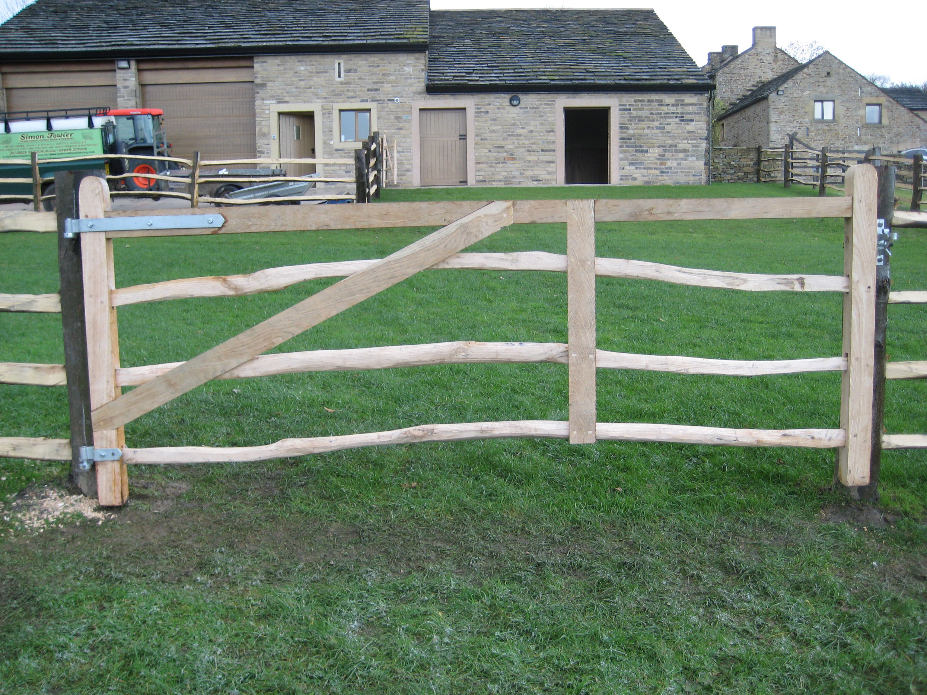 <span>Ref: F7</span><br>A field gate hung on round posts to match the cleft fencing surrounding the paddock; end pieces, brace and top rail are of sawn chestnut; 4' x 10'; £960 inc VAT.