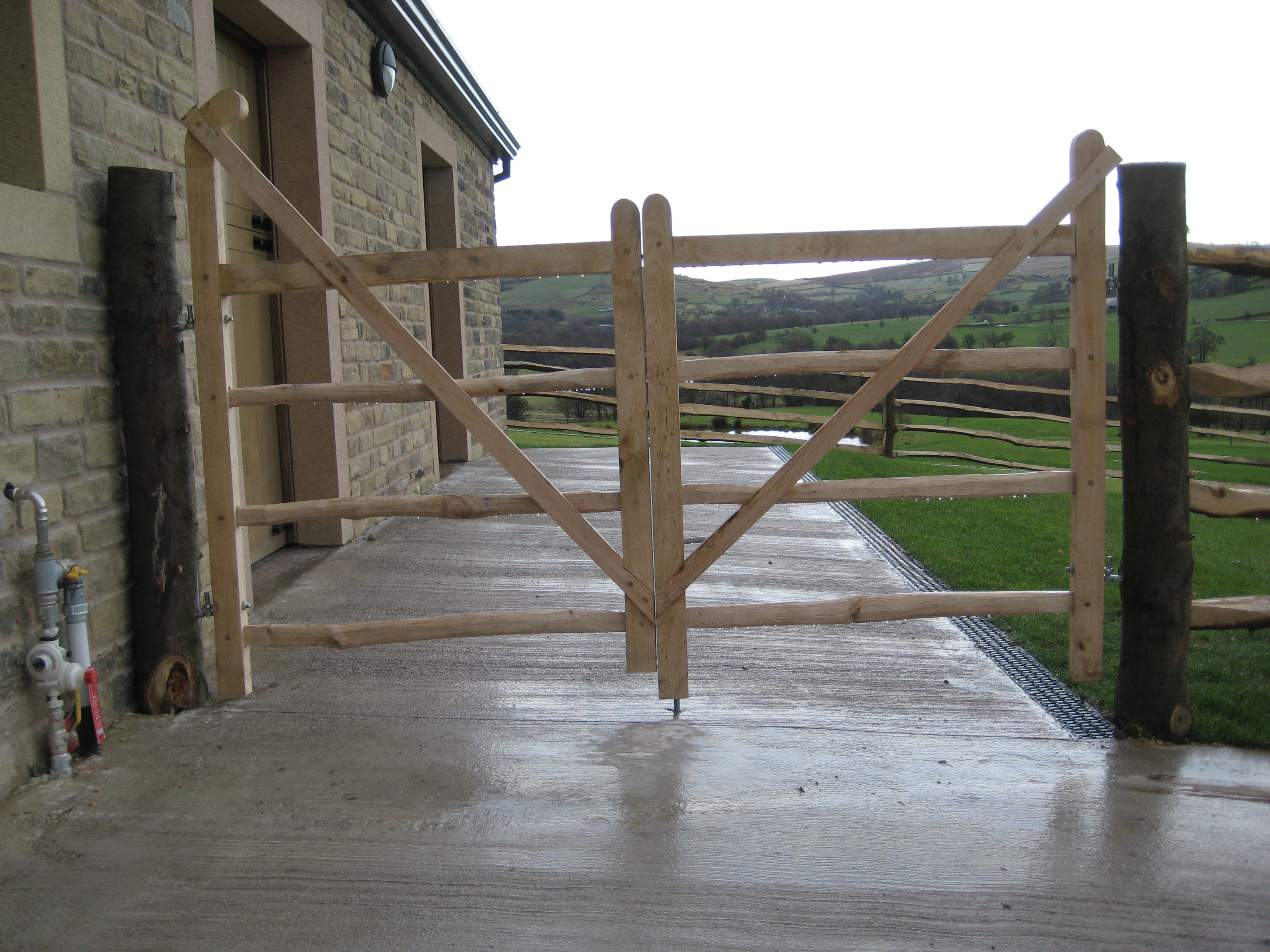 <span>Ref: F17</span><br>A pair of four railed gates, one with a ranch top brace, the right gate with a raised brace, both 4' x 4' wide; left hand gate £516 inc VAT, right hand gate £396 inc VAT.