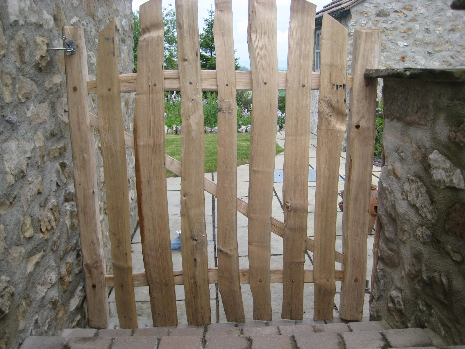 <span>Ref: F25</span><br>A 4' square gate made entirely from cleft chestnut with pales cut in a curved top, Winster, Derbyshire; £396 inc VAT.