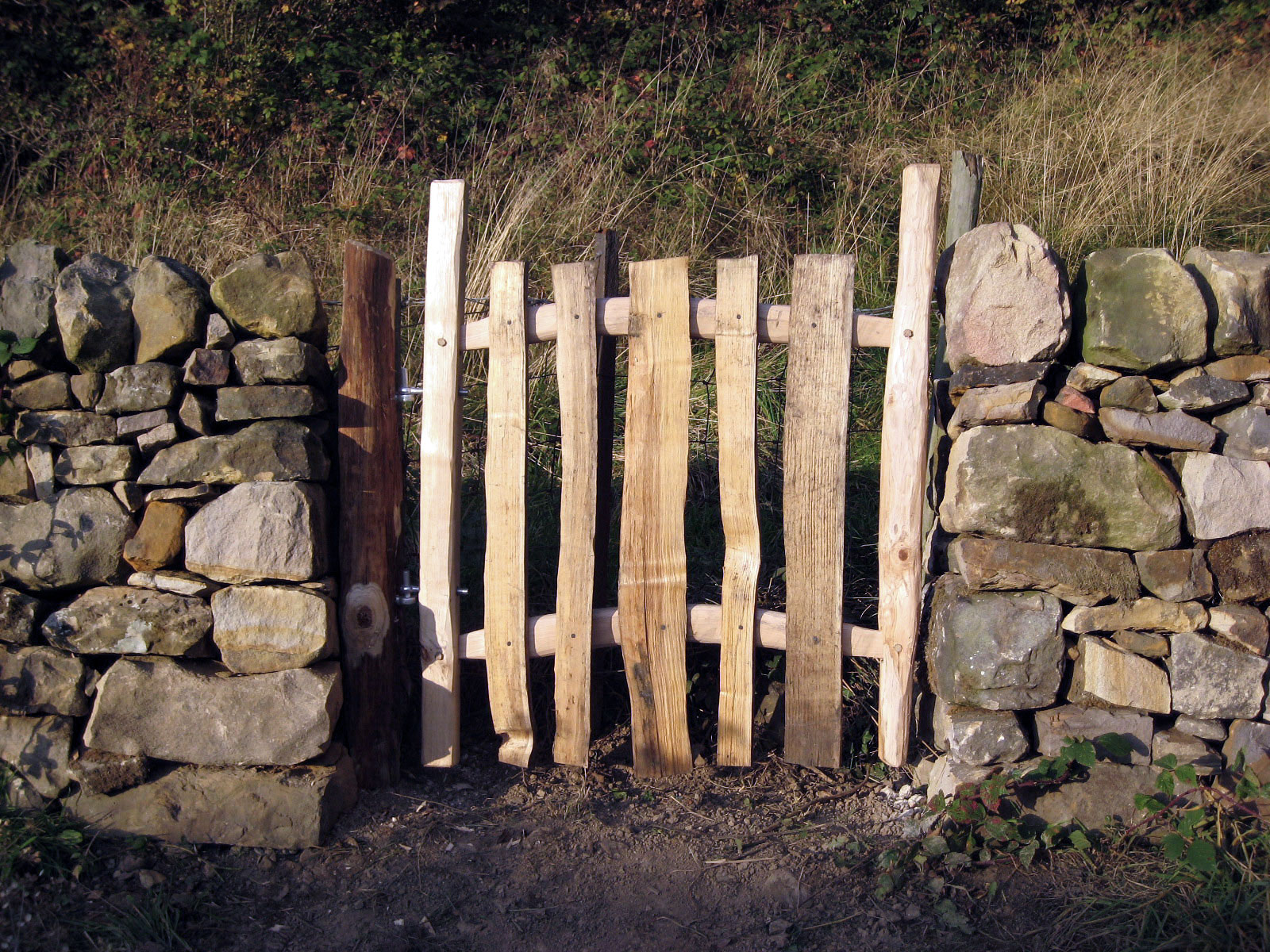 <span>Ref: F23</span><br>All parts of this simple gate are cleft chestnut, which reflects the rough nature of the drystone wall in Matlock, Derbyshire, 3' x 3' wide; £330 inc VAT.
