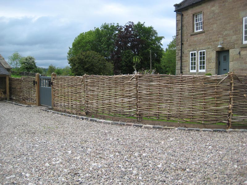 <span>Ref: B6</span><br>3' high hazel hurdles secure the garden of this period house.
