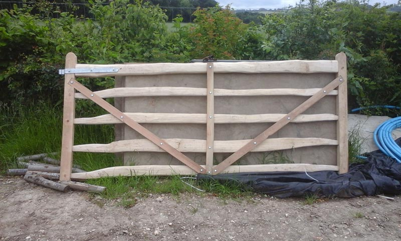 <span>Ref: F13</span><br>A half diamond pattern field gate with cleft rails and sawn ends and braces, note the notched brace ends to prevent sagging, Chilterns, 4' x 10' long; £1056 inc VAT.