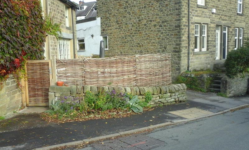 "<span>Ref: B8</span><br>""Hazel hurdles with matching oak framed gate screen this house from the street while remaining true to the appearance of the building."