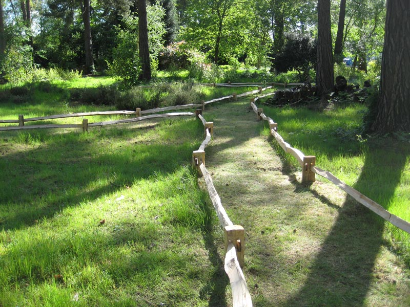 <span>Ref: A30</span><br>A low cleft rail delineating the paths within a woodland garden, Windsor, London; materials approx £7.50/metre inc. VAT