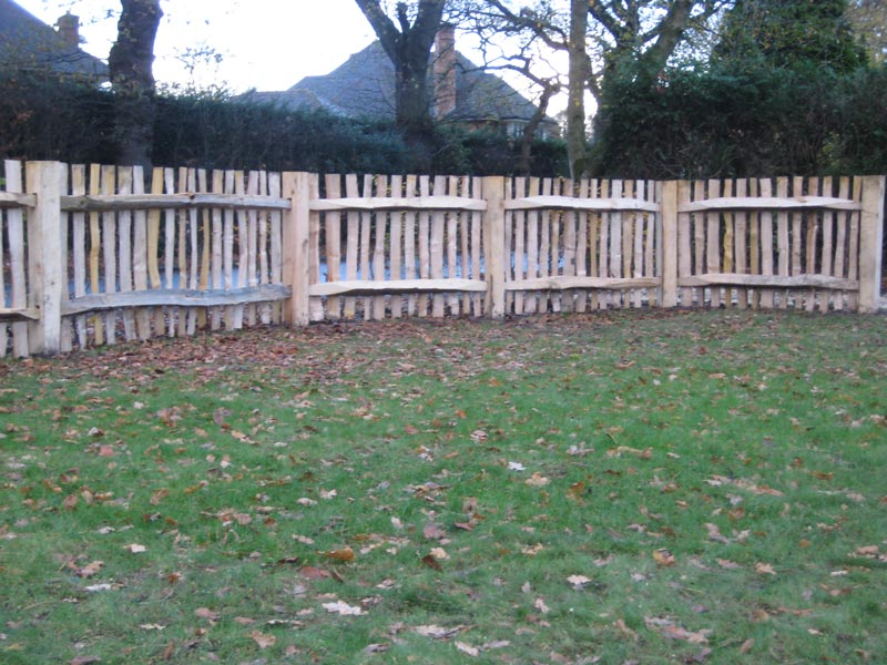 <span>Ref: A39</span><br>The inside of this pale fence shows cleft chestnut rails and sawn chestnut posts, Knutsford, Cheshire; materials approx £35.54/metre inc. VAT