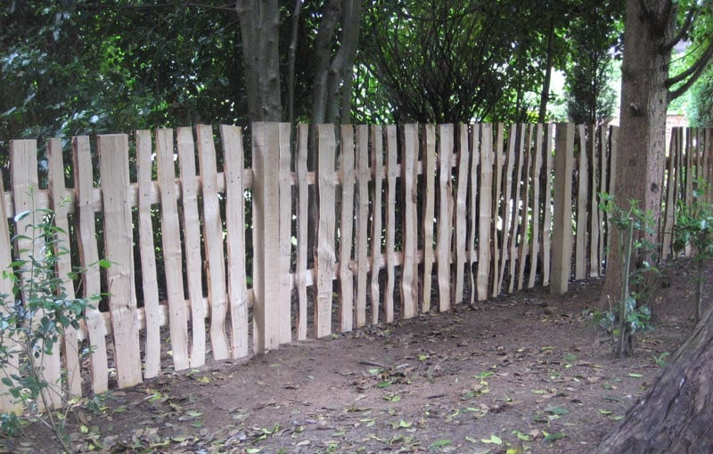 "<span>Ref: A34</span><br>Riven chestnut pales at 4' attached to cleft rails which are screwed to 4"" square chestnut posts, Knutsford, Cheshire; materials approx £33.53/metre inc. VAT"