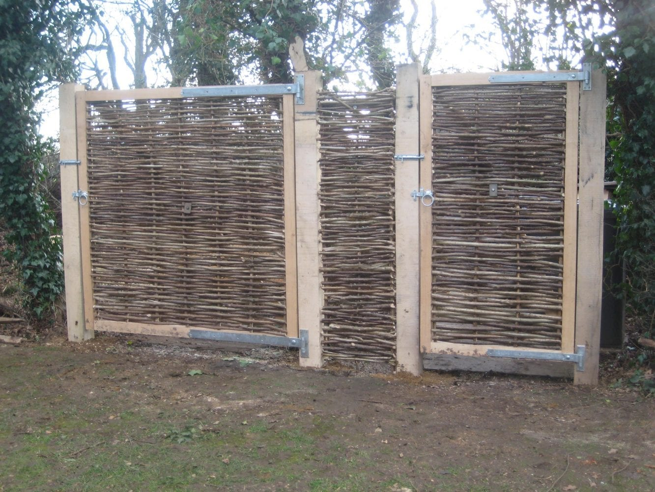 <span>Ref: F35</span><br>Large oak framed hazel infill gates to screen wheely bins and compost, Banbury, Oxfordshire; left gate 6' x 6' wide £800 and right gate 6' x 3' wide £480 inc VAT.
