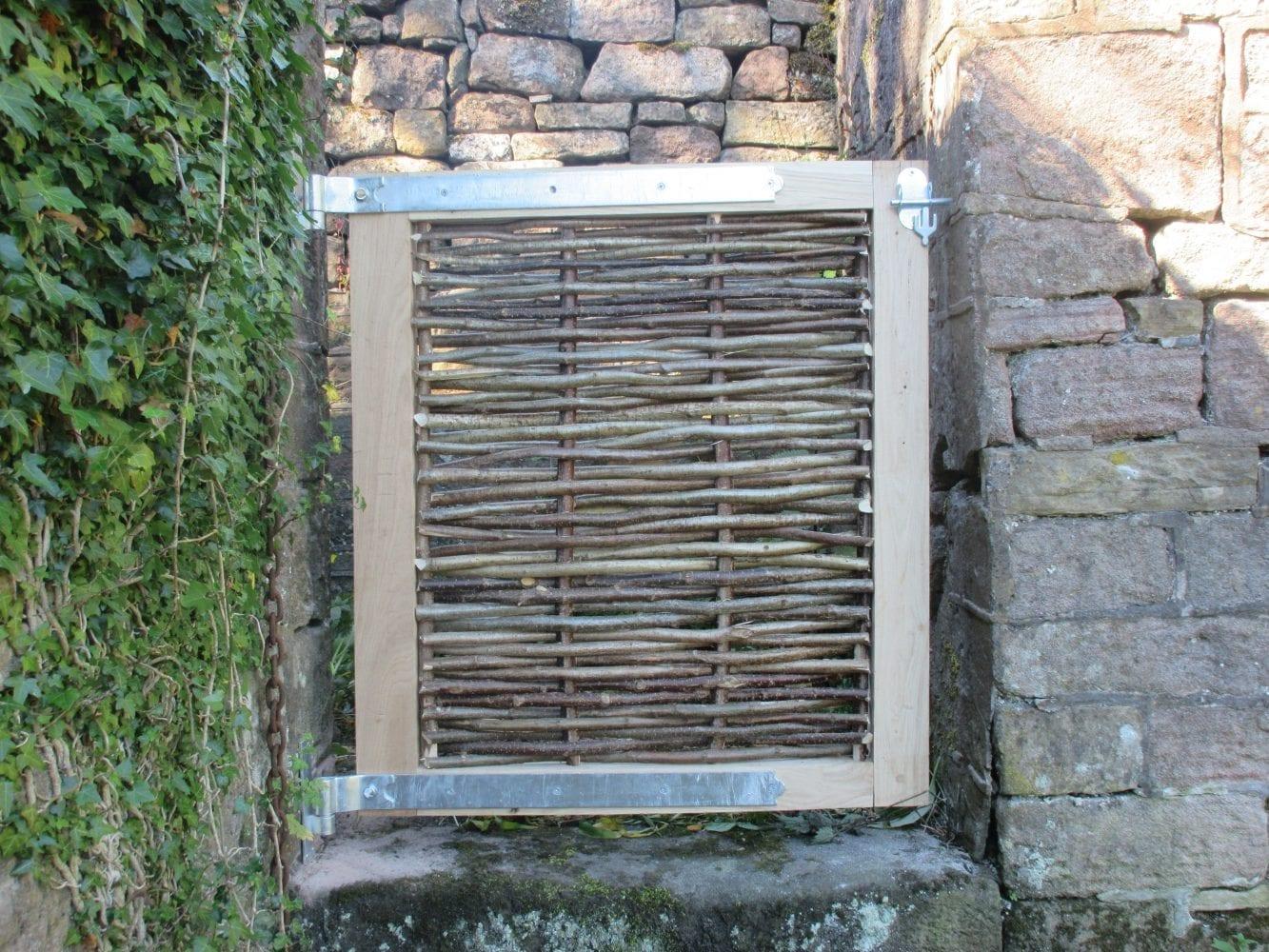 <span>Ref: F38</span><br>Oak framed hazel infill gate secures this passage against the dog, 3' x 3' wide; £330 inc VAT.