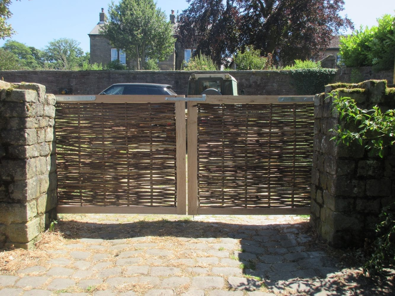 <span>Ref: F39</span><br>A pair of oak framed hazel infill gates, each 4' x 5' wide; £572 inc VAT each.