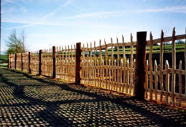 <span>Ref: A45</span><br>Half round chestnut pales screwed onto cleft rails and supported by chestnut posts makes a less heavy 4' fence around a fruit garden; materials approx £43.85/metre inc. VAT