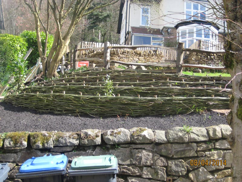 <span>Ref: D13</span><br>Low willow spiling creates terraces in this steep garden, allowing easier access.