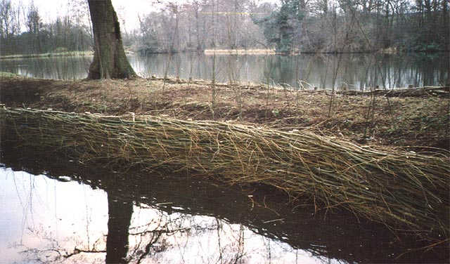 <span>Ref: D1</span><br>Winter: willow rods woven about willow posts driven into the bank. The rough finish reduces the river current protecting the bank and is an ideal site for nesting birds.